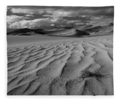 Storm Over Sand Dunes Fleece Blanket
