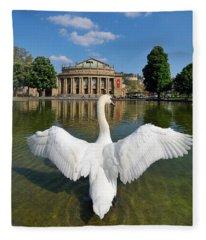 Swan Spreads Wings In Front Of State Theatre Stuttgart Germany Fleece Blanket