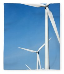 Three Mighty Windmills In A Row Against A Blue Sky. Fleece Blanket