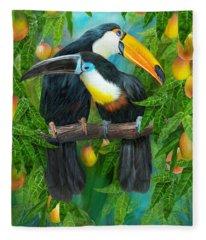 Fleece Blanket featuring the mixed media Tropic Spirits - Toucans by Carol Cavalaris