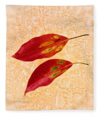 Two Red Leaves On Pink Background Fleece Blanket