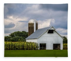 White Barn And Silo With Storm Clouds Fleece Blanket