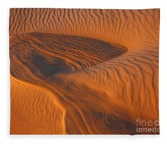 Woman In The Dunes Fleece Blanket