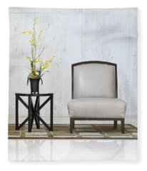 A Chair And A Table With A Plant  Fleece Blanket