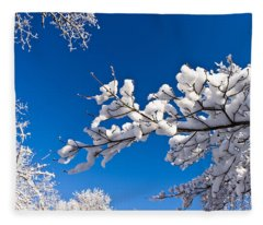 Snowy Trees And Blue Sky Fleece Blanket