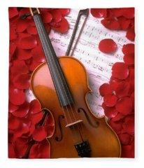 Violin On Sheet Music With Rose Petals Fleece Blanket