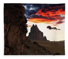 A Shiprock Landscape Against A Breathtaking Twilight Sky Fleece Blanket