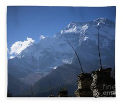 Fleece Blanket featuring the photograph Buddhist Gompa And Prayer Flags In The Himalaya Range, Annapurna Region, Nepal by Raimond Klavins