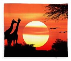 Giraffes At Sunset Fleece Blanket