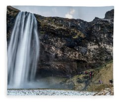 Fleece Blanket featuring the photograph Seljalandsfoss Waterfalls View In Winter, Iceland by Pradeep Raja PRINTS