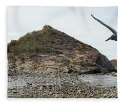 A Brown Pelican Does A Flyby Of A Cactus Covered Desert Island  Fleece Blanket