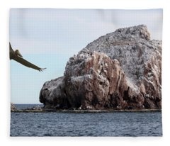 A Brown Pelican Does A Flyby Of A Guano Covered Desert Island  Fleece Blanket