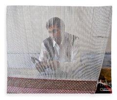 A Weaver Weaves A Carpet. Fleece Blanket