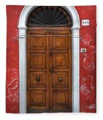 an old wooden door in Italy Fleece Blanket