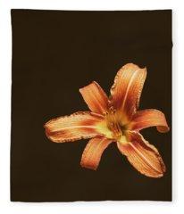 An Orange Lily Fleece Blanket