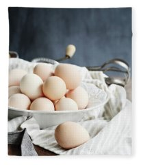Apron And Eggs On Wooden Table Fleece Blanket