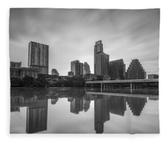 Fleece Blanket featuring the photograph Austin Texas Skyline Reflecting In Ladybird Lake Long Exposure by Todd Aaron