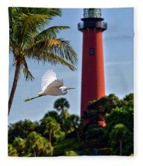 Bird In Flight Under Jupiter Lighthouse, Florida Fleece Blanket