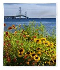 Blooming Flowers By The Bridge At The Straits Of Mackinac Fleece Blanket