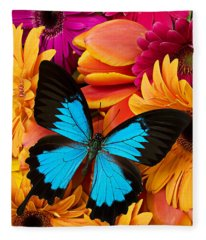 Blue Butterfly On Brightly Colored Flowers Fleece Blanket