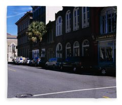 Buildings On Both Sides Of A Road Fleece Blanket