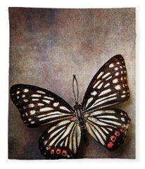 Butterfly Over Textured Background Fleece Blanket