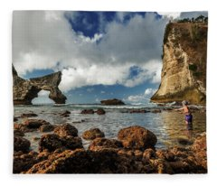 Fleece Blanket featuring the photograph catching fish in Atuh beach by Pradeep Raja Prints