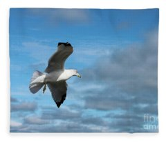 Closeup Of Seagull In Flight Against Stormy Cloudy Sky Fleece Blanket