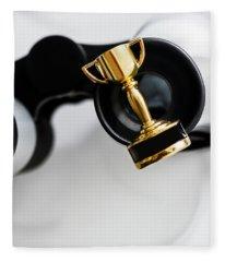 Closeup Of Small Trophy And Binoculars On White Background Fleece Blanket