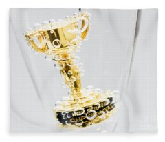 Closeup Of Small Trophy In Champagne Flute. Gold Colored Award I Fleece Blanket
