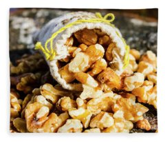 Closeup Of Walnuts Spilling From Small Bag Fleece Blanket