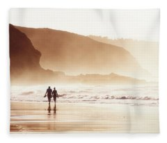 Couple Walking On Beach With Fog Fleece Blanket