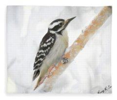 Downy Woodpecker Clinging To A Branch. Fleece Blanket