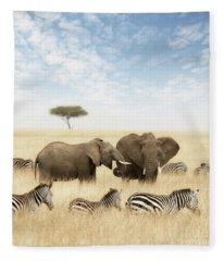 Elephants And Zebras In The Grasslands Of The Masai Mara Fleece Blanket