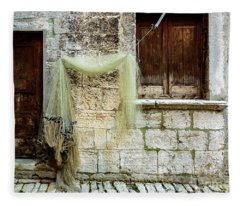 Fishing Net Hanging In The Streets Of Rovinj, Croatia Fleece Blanket