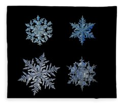 Four Snowflakes On Black Background Fleece Blanket