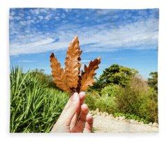 Hand Holding A Beautiful Oak Leaf Fleece Blanket