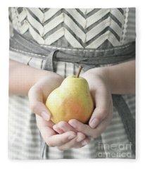 Hands Holding Yellow Pear Fleece Blanket