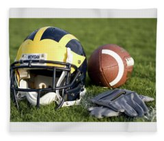 Helmet On The Field With Football And Gloves Fleece Blanket