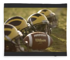 Helmets And A Football On The Field At Dawn Fleece Blanket