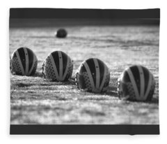 Helmets On Dew-covered Field At Dawn Black And White Fleece Blanket