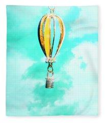 Hot Air Balloon Pendant Over Cloudy Background Fleece Blanket