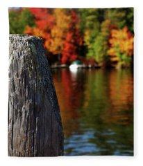 Lake Winnepesaukee Dock With Foliage In The Distance Fleece Blanket
