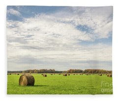 Large, Round, Bales Of Hay Under A Blue Sky With Clouds Fleece Blanket
