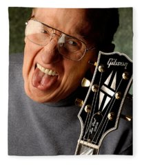 Les Paul With Tongue Out By Gene Martin Fleece Blanket