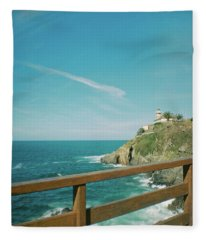 Lighthouse Over The Ocean Fleece Blanket