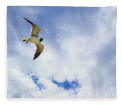 Lone Seagull Glides Against Cloudy Sky Fleece Blanket