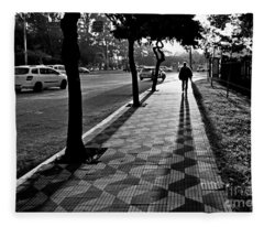 Lonely Man Walking At Dusk In Sao Paulo Fleece Blanket