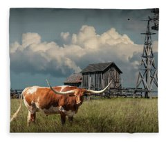 Longhorn Steer In A Prairie Pasture By Windmill And Old Gray Wooden Barn Fleece Blanket