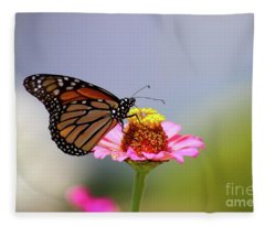 Monarch Butterfly Extracting Nectar From A Pink Zinnia Fleece Blanket